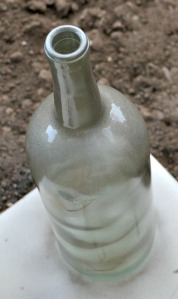 Shake the spray paint and apply a thin, even coat of paint to the exterior of the wine bottle and interior of the votive