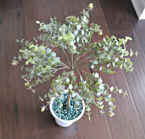 Dress up a fake plant with metallic coffee beans in the pot