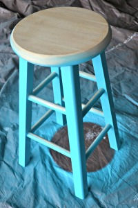 Turned the stool upright and cleaned the top surface before painting