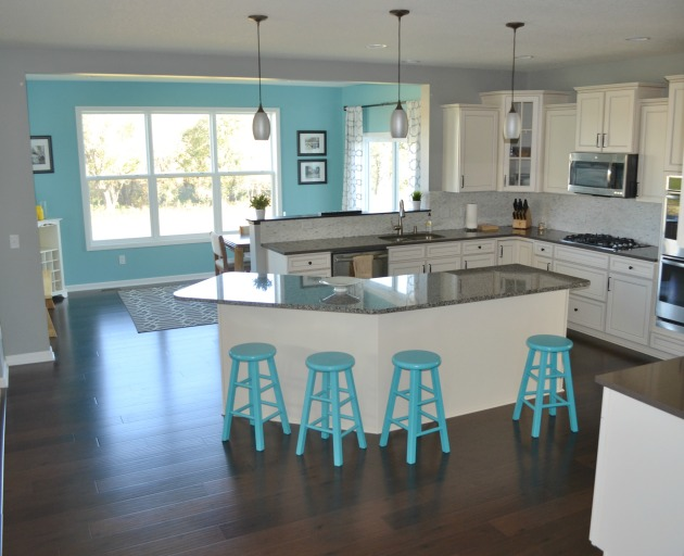 Finished Stools add a pop of color to our kitchen