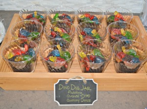 Dinosaur Dig Jars with Pudding, crushed Oreo cookies, and gummy dinosaurs